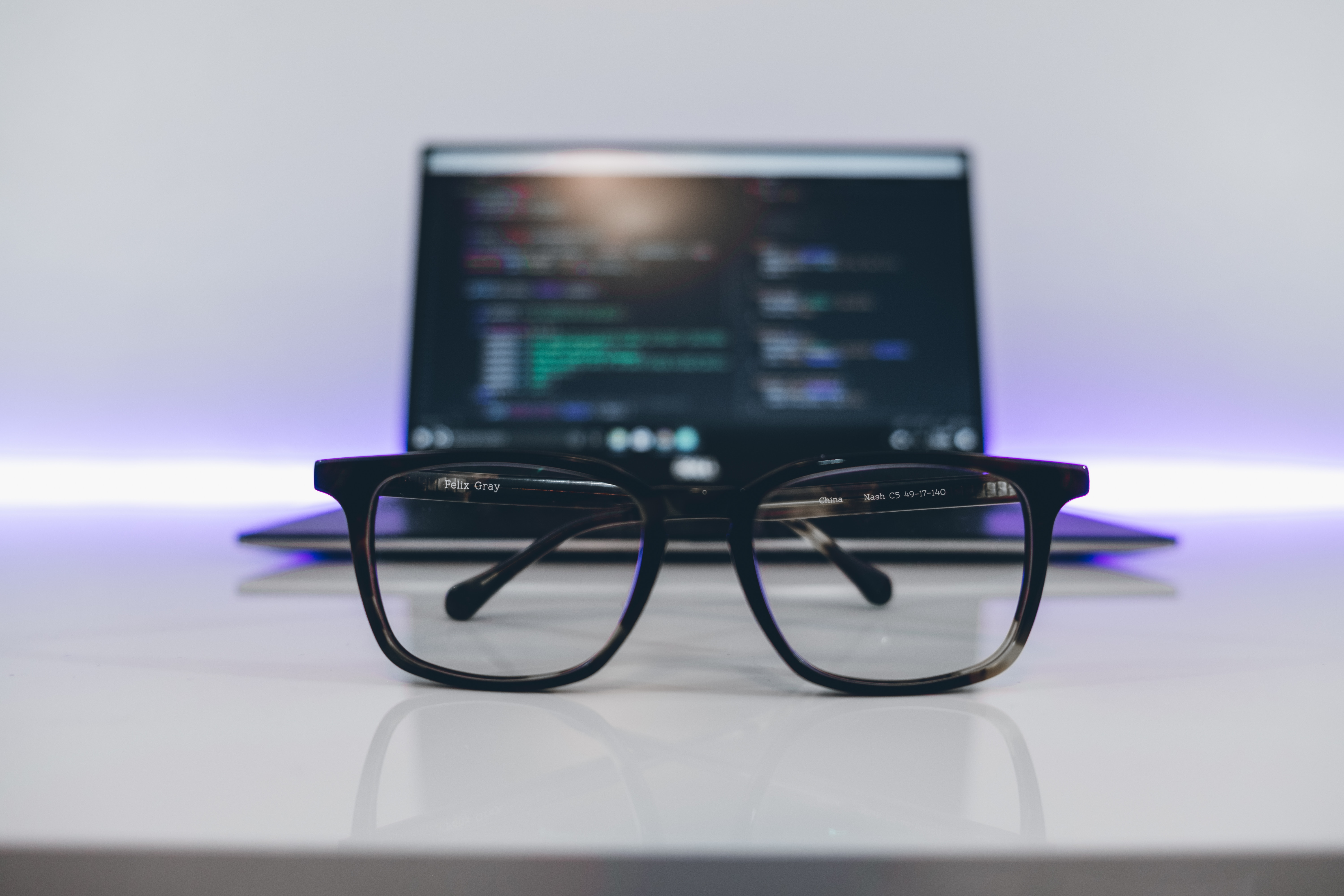 Glasses in front of a laptop screen
