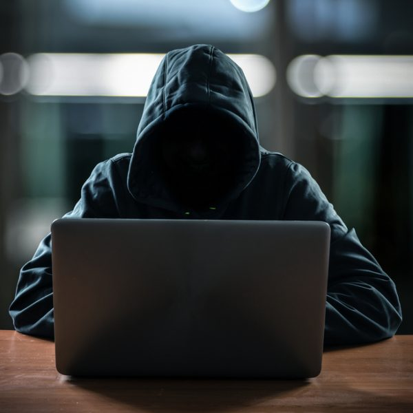hacker-in-front-of-laptop-wearing-sweatshirt