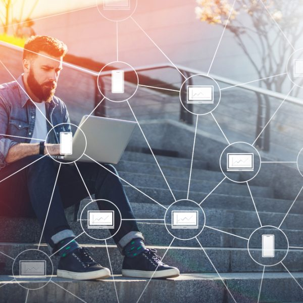 man-sitting-on-steps-with-laptop-blockchain